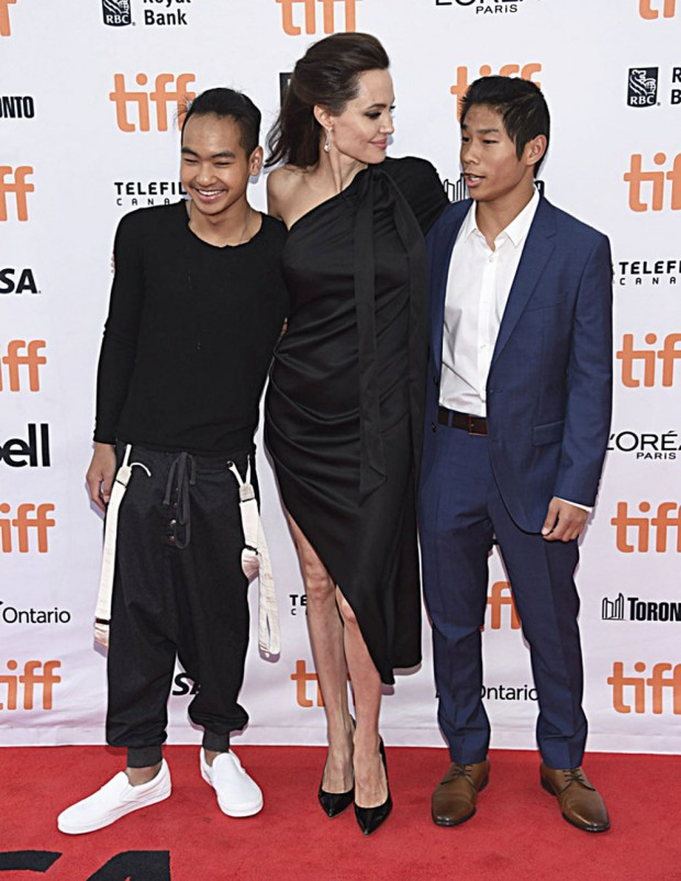 """Mandatory Credit: Photo by Invision/AP/REX/Shutterstock (9050674aa) Maddox Jolie-Pitt, Angelina Jolie, Pax Jolie-Pitt. Maddox Jolie-Pitt, from left, Angelina Jolie and Pax Jolie-Pitt attend a premiere for """"First They Killed My Father"""" on day 5 of the Toronto International Film Festival at the Princess of Wales Theatre, in Toronto 2017 TIFF - """"First They Killed My Father"""" Premiere, Toronto, Canada - 11 Sep 2017"""