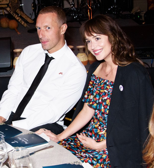 """EXCLUSIVE: Chris Martin and Dakota Johnson Attend """"Place for Peace"""" Event (Whitaker Peace & Development Initiative ) During the event, there was an auction where a Star Trooper Type Helmet was auctioned off and won by attendee at their table. Today is Chris Martin's ex-Gwyneth Paltrow's birthday. Gotham Hall, NY. 27 Sep 2019 Pictured: Chris Martin, Dakota Johnson. Photo credit: MEGA TheMegaAgency.com +1 888 505 6342 (Mega Agency TagID: MEGA515160_001.jpg) [Photo via Mega Agency]"""