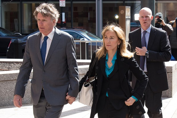 Felicity Huffman arrives to Federal Court in Boston today to face charges in a nationwide college admissions bribery scandal Pictured: Felicirty Huffman Ref: SPL5076809 030419 NON-EXCLUSIVE Picture by: Katy Rogers / SplashNews.com Splash News and Pictures Los Angeles: 310-821-2666 New York: 212-619-2666 London: 0207 644 7656 Milan: 02 4399 8577 photodesk@splashnews.com World Rights